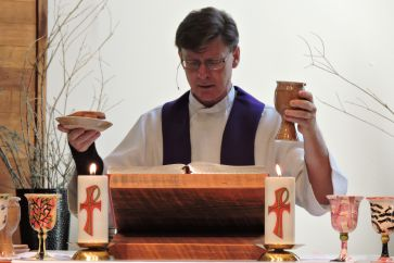 2015 LCR Pastor at altar post img 363 x 242-72ppi